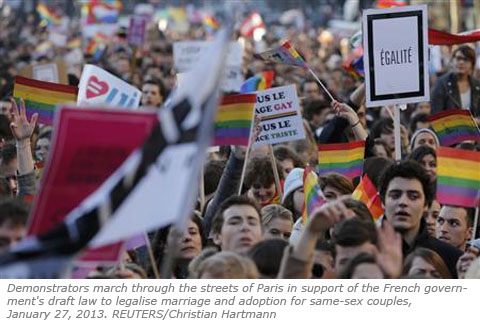 Demonstrators march through the streets of Paris in support of the French government's draft law to legalise marriage and adoption for same-sex couples