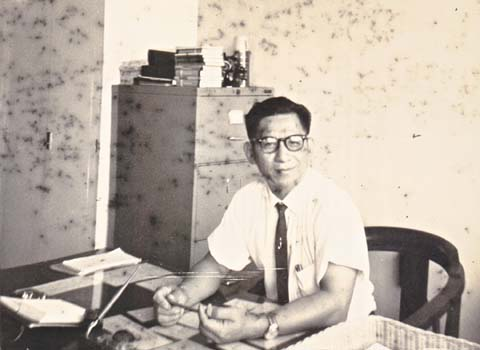 Au Keng Chu at the principal's desk, Dunman Secondary School, mid 1960s