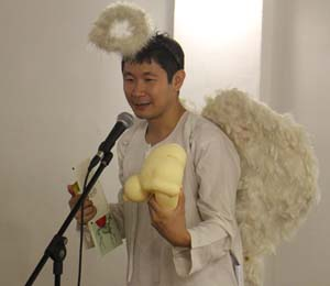 Ng Yi-Sheng emceeing ContraDiction 2013, an event in Singapore's annual Pride season.