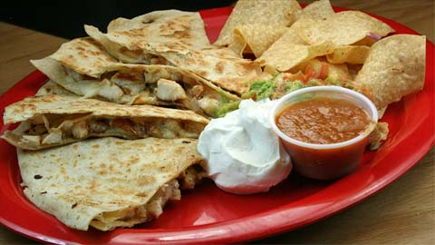 "A google search of ""quesadilla"" and ""calories"" turns up a result indicating that chicken quesadillas have 293 calories per 100g (sources include USDA)"