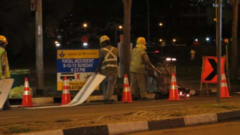Road crew repairing road where the accident, riot and arson occurred