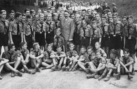 The People's Association is nowhere as martial as Hitler Youth, but there are eerie similarities between this picture and countless ones in the People's Association's annual reports, testifying to perhaps similar aims.