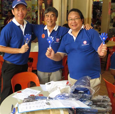Singapore First Party organise their election materials at a coffee shop