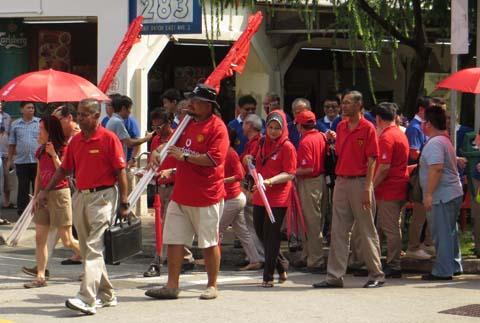 Sadasivam Veriyah of SDP (second from left) leading his supporters as they walk to the nomination centre