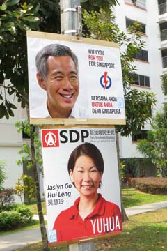 In Yuhua constituency, Jaslyn Go (SDP) is standing against Grace Fu of PAP. However, many lamp posts feature Lee Hsien Loong's face instead.