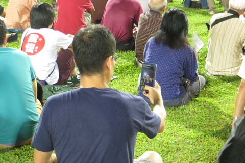 Checking his selfie while at a rally