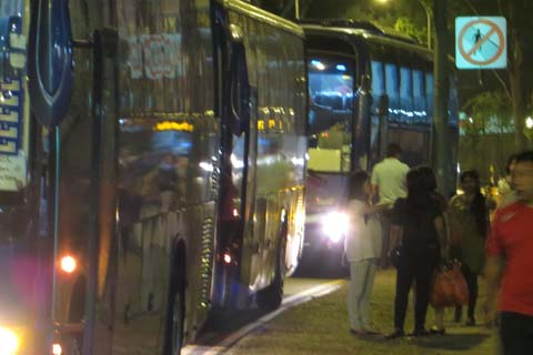 Saying good night to each other before boarding the buses