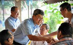 The Workers' Party's Low Thia Khiang (left)_ and Png Eng Huat (centre) greeting residents.
